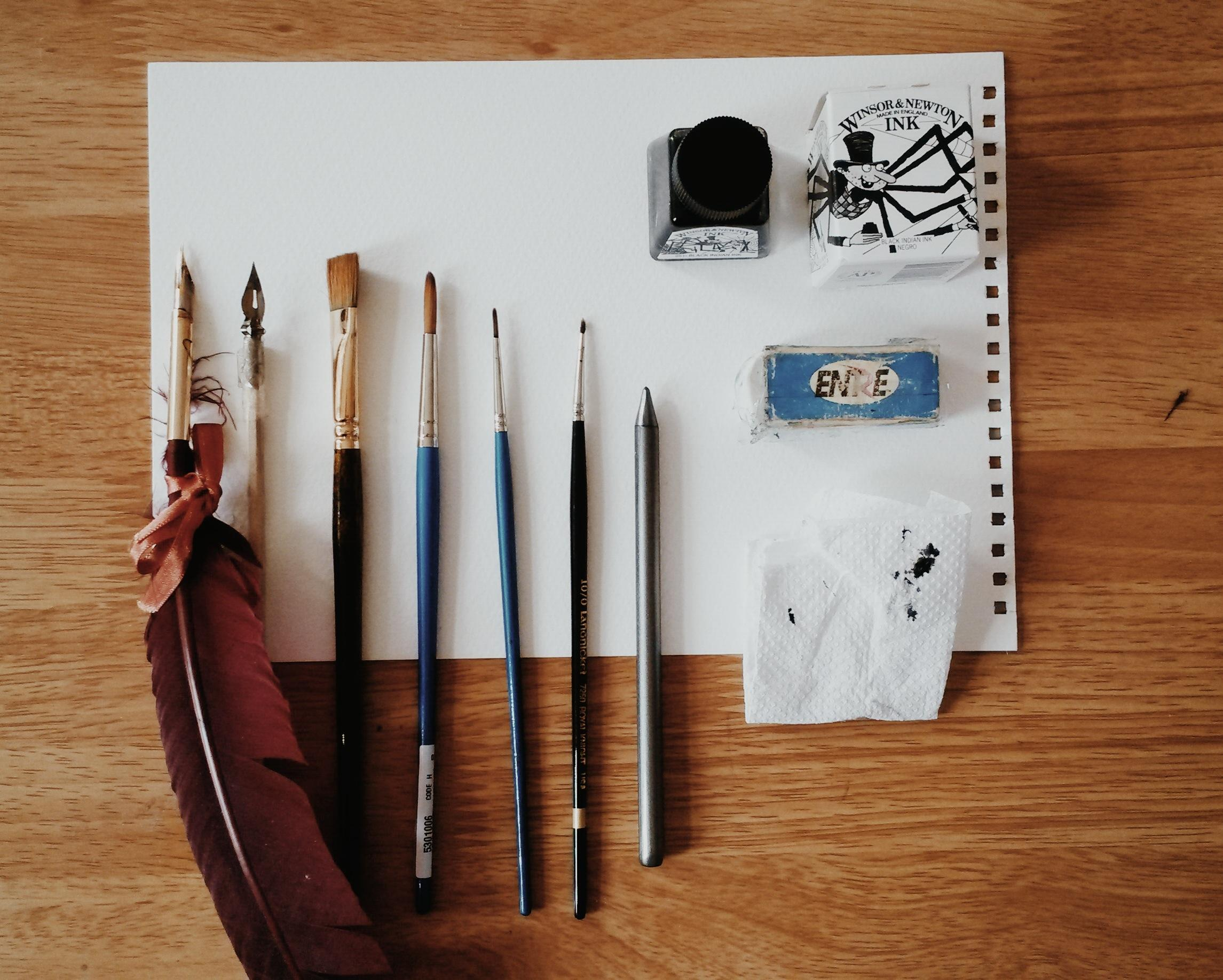 Paintbrushes, Winsor & Newton india ink and dip pens for creating illustrations