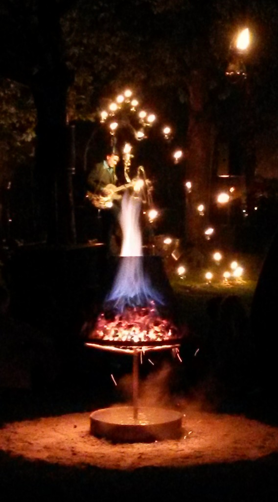 Carabosse Fire Gardens - musician performing in Bournemouth Gardens, lit by fire